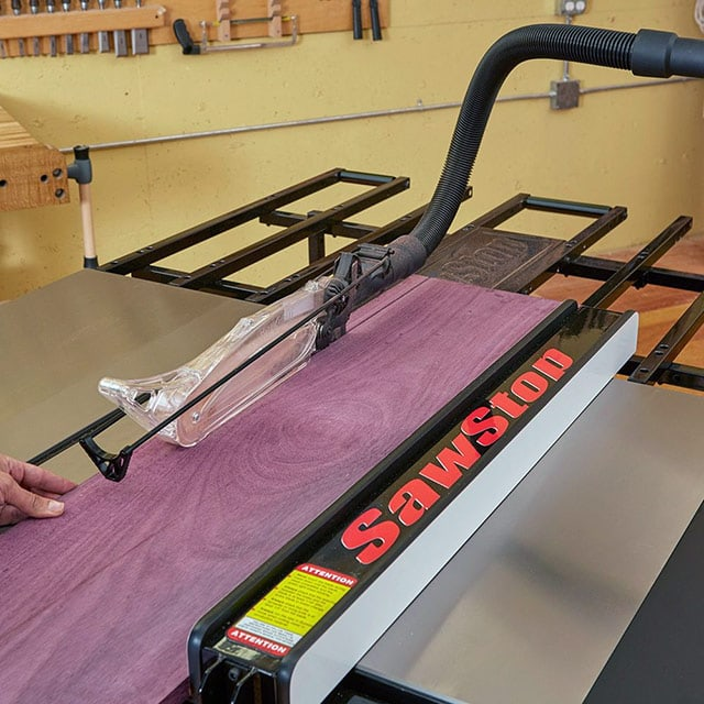 SawStop folding outfeed table cutting purple heart board