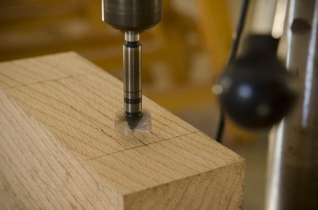 Forstner drill bit spinning on a drill press