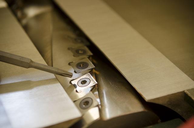 tightening carbide blade on jointer spiral cutterhead