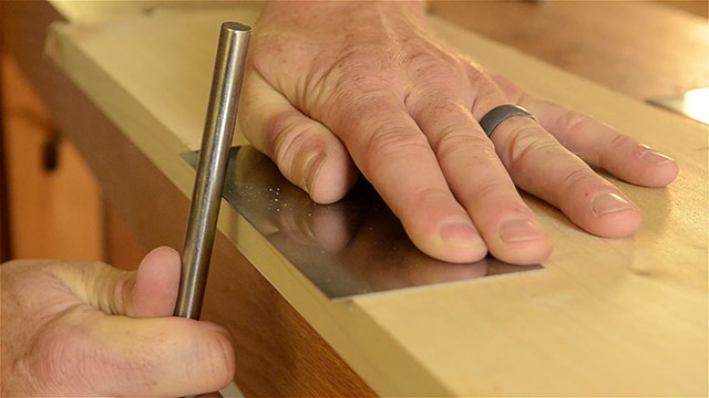 Turning the hook on a card scraper with a burnisher