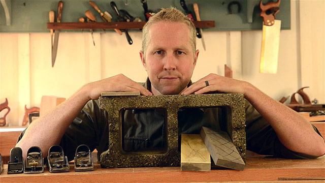 Joshua Farnsworth testing to see if a cinder block will flatten waterstones