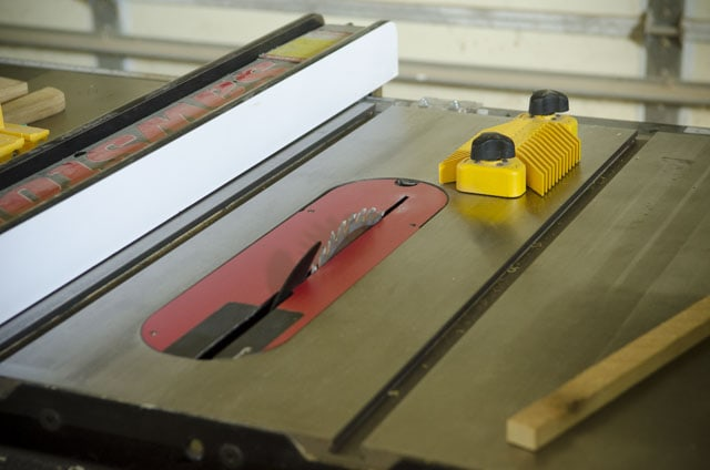 Yellow Magswitch magnetic feather board on a SawStop table saw