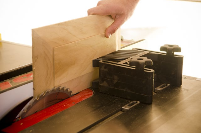 Rockler Double Featherboard holding a raised panel that was just cut on a table saw