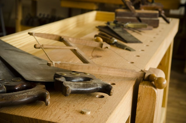 Portable Moravian workbench with hand saws & hand planes on the top