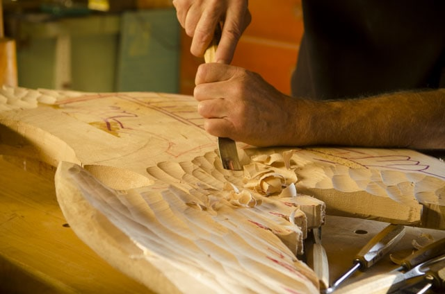 Wood carver William Brown carving a Bellamy Eagle