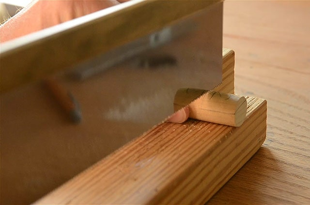 Using a Lie-Nielsen carcass back saw to cut a round dowel for a workbench bench dog