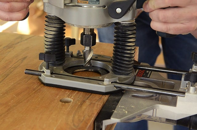 Using a Bosch plunge router to bore workbench dog holes