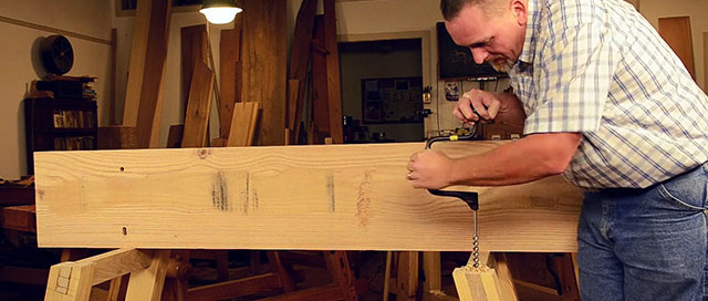 Will Myers Using A Brace And Bit To Bore A Hole In A Moravian Workbench For Blind Pegging The Top To The Undercarriage
