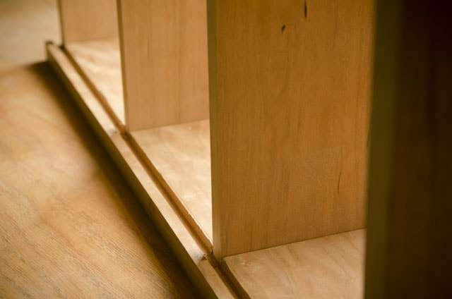 plowed groove on the back of a cherry cupboard