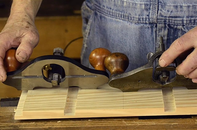 Open throat router plane next to closed throat router plane