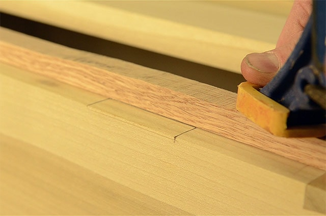 Clamping safety board to prevent blowout when installing butt hinges on a dovetail chest
