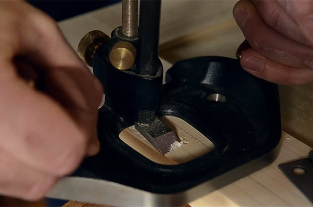 Cleaning out a hinge mortise with a router plane marking a mortise with a marking knife and square while Installing butt hinges on the lid of a dovetail chest
