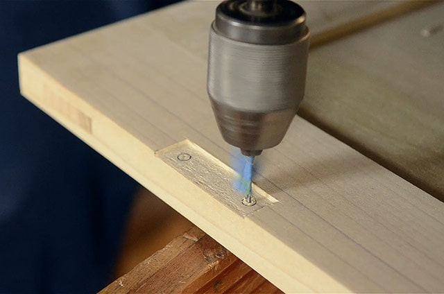 Boring hinge holes marking a mortise with a marking knife and square while Installing butt hinges on the lid of a dovetail chest