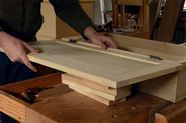 Resting a box lid on boards while Installing butt hinges on the lid of a dovetail chest