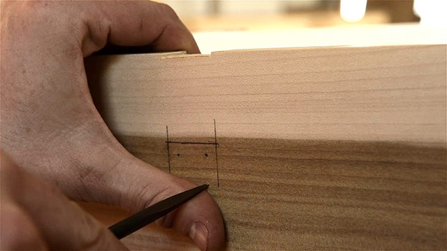 Woodworker Using An Awl To Start A Hole Before Boring Screw Holes Into Historical Hasp Hardware Installed On A Dovetail Chest
