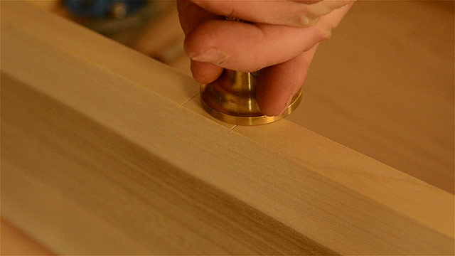Woodworker Installing A Hasp On A Historical Dovetail Chest