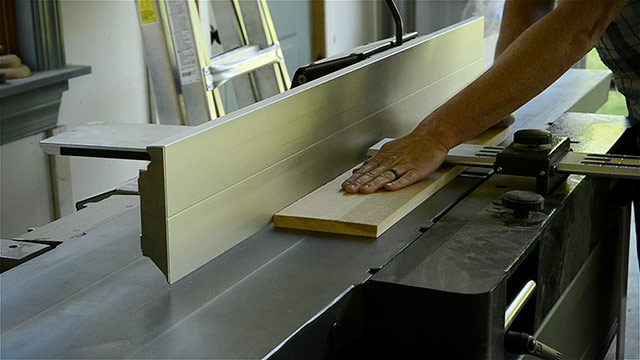 Woodworker Using A Wood Planer To Square Boards For Woodworking