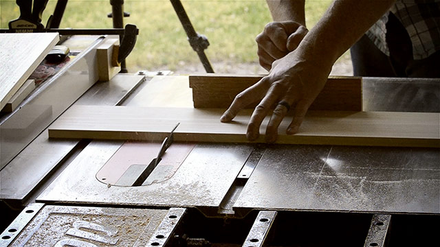 Joshua Farnsworth Cross Cutting Lumber Boards With A Miter Gauge On A Saw Stop Cabinet Table Saw For A Dovetail Box