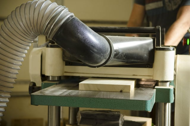 Best Thickness Planer For Woodworking - Poplar Board Being Milled On A Wood Planer