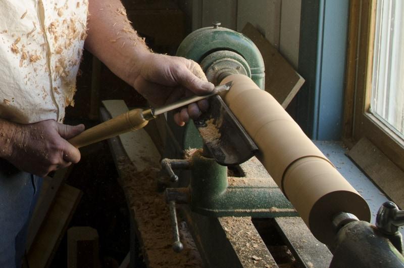 Wood Turner Using Wood Turning Tools Skew Chisel On A Wood Lathe
