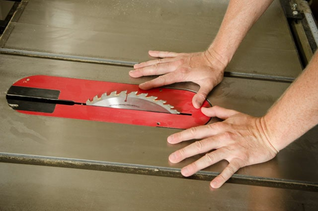 Hands Next To A Table Saw Blade Best Table Saw Guide