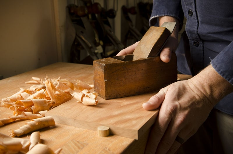 Hand Planing A Cherry Board With A Coffin Smoothing Plane Which Is A Woodworking Hand Tool